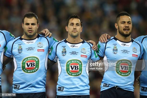 Wade Graham Mitchell Pearce and Jarryd Hayne of the Blues sings the National Anthem before game three of the State Of Origin series between the...