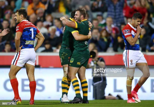 Wade Graham of Australia celebrates one of his tries with team mates during the 2017 Rugby League World Cup match between Australian Kangaroos and...