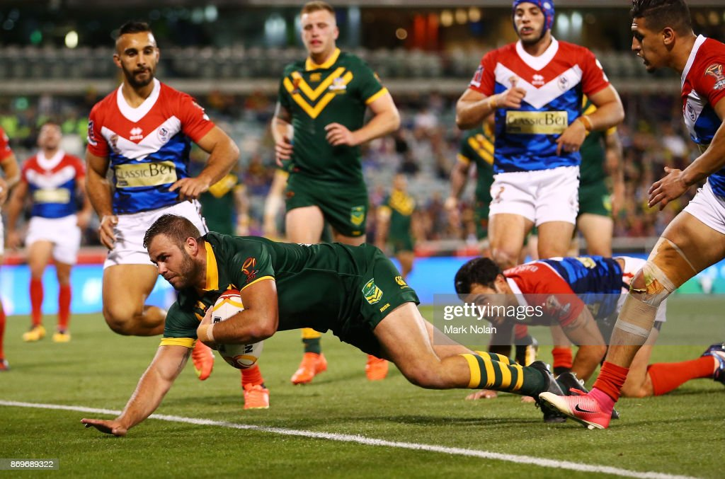 Wade Graham of Australia dives to score a try during the 2017 Rugby League World Cup match between Australian Kangaroos and France at Canberra Stadium on November 3, 2017 in Canberra, Australia.