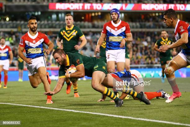 Wade Graham of Australia dives to score a try during the 2017 Rugby League World Cup match between Australian Kangaroos and France at Canberra...