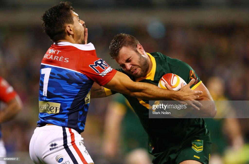 Wade Graham of Australia heads to the try line to score during the 2017 Rugby League World Cup match between Australian Kangaroos and France at Canberra Stadium on November 3, 2017 in Canberra, Australia.