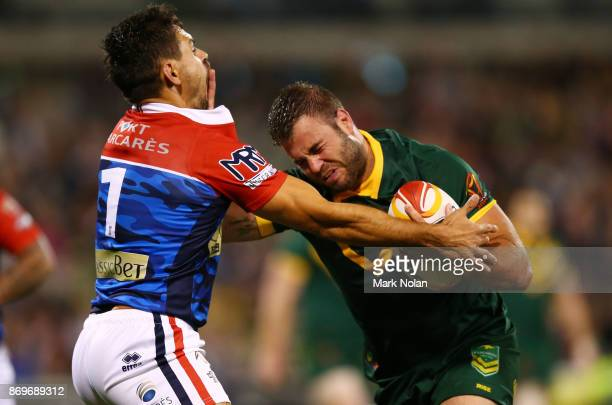 Wade Graham of Australia heads to the try line to score during the 2017 Rugby League World Cup match between Australian Kangaroos and France at...