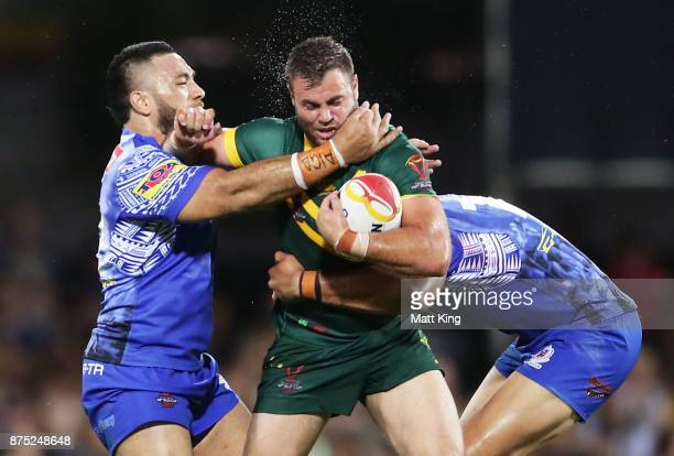 Wade Graham of Australia is tackled during the 2017 Rugby League World Cup Quarter Final match between Australia and Samoa at Darwin Stadium on...