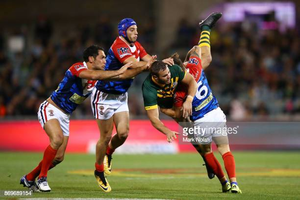 Wade Graham of Australia is up ended after offloading during the 2017 Rugby League World Cup match between Australian Kangaroos and France at...