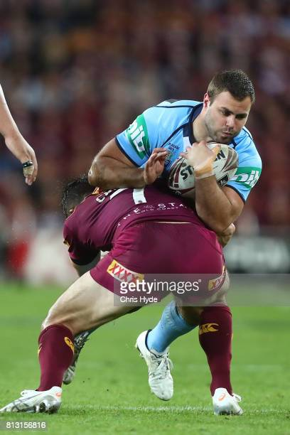 Wade Graham of the Blues is tackled during game three of the State Of Origin series between the Queensland Maroons and the New South Wales Blues at...