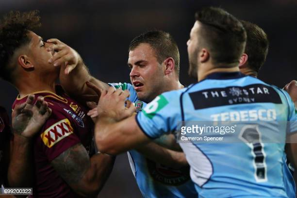 Wade Graham of the Blues is tackled during game two of the State Of Origin series between the New South Wales Blues and the Queensland Maroons at ANZ...