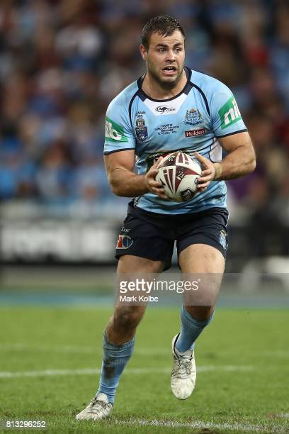 Wade Graham of the Blues runs the ball during game three of the State Of Origin series between the Queensland Maroons and the New South Wales Blues...