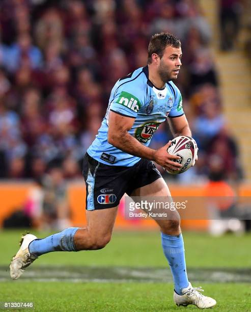 Wade Graham of the Blues runs with the ball during game three of the State Of Origin series between the Queensland Maroons and the New South Wales...