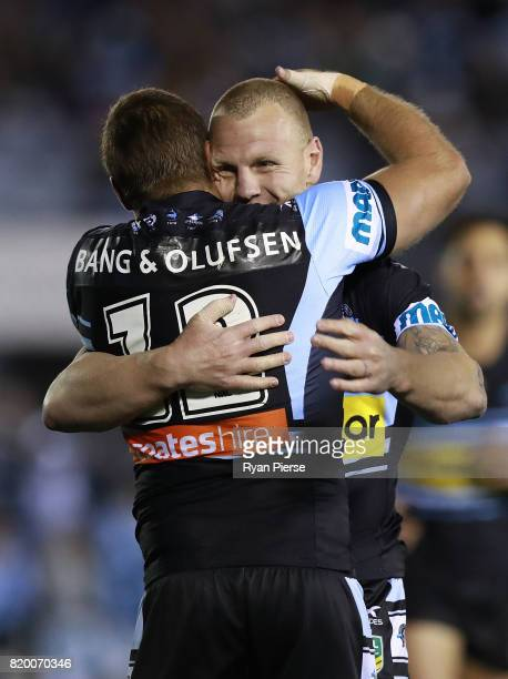Wade Graham of the Sharks celebrates with teammate Luke Lewis after he scored a try during the round 20 NRL match between the Cronulla Sharks and the...