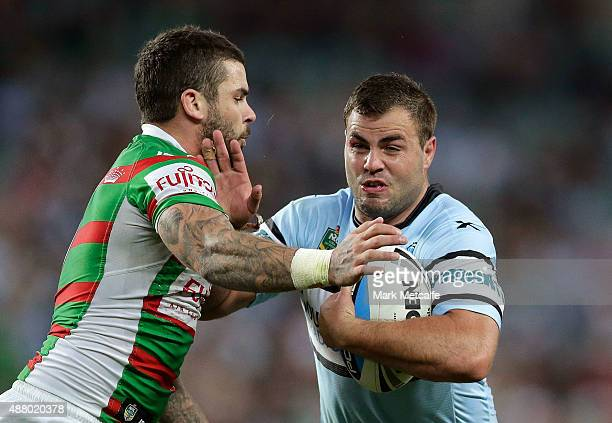 Wade Graham of the Sharks is tackled by Adam Reynolds of the Rabbitohs during the NRL Elimination Final match between the Cronulla Sharks and the...