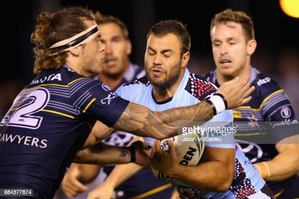 Wade Graham of the Sharks is tackled by Ethan Lowe of the Cowboys during the round 11 NRL match between the Cronulla Sharks and the North Queensland...
