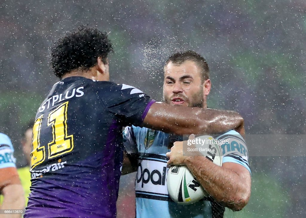 Wade Graham of the Sharks is tackled by Felise Kaufusi of the Melbourne Storm during the round six NRL match between the Melbourne Storm and the Cronulla Sharks at AAMI Park on April 9, 2017 in Melbourne, Australia.