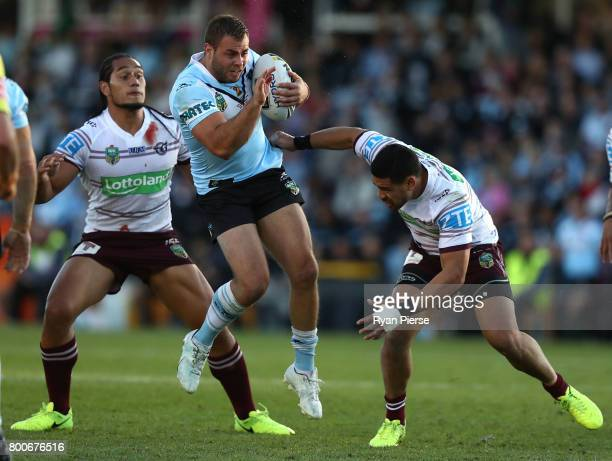 Wade Graham of the Sharks is tackled by Frank Winterstein of the Sea Eagles during the round 16 NRL match between the Cronulla Sharks and the Manly...