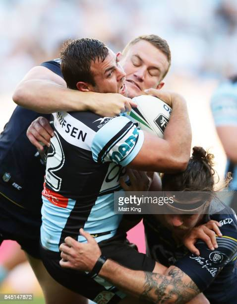 Wade Graham of the Sharks is tackled during the NRL Elimination Final match between the Cronulla Sharks and the North Queensland Cowboys at Allianz...