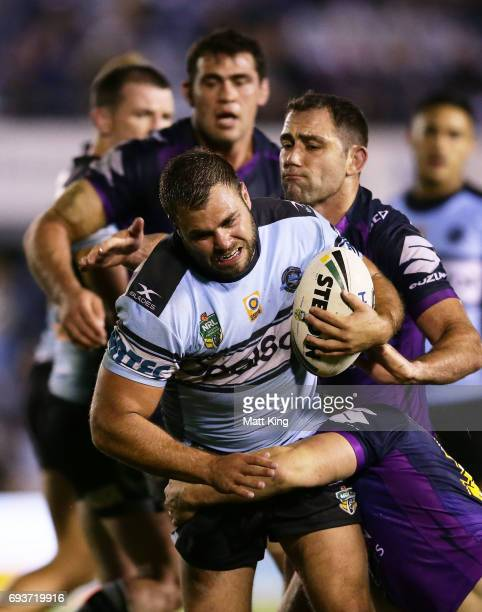 Wade Graham of the Sharks is tackled during the round 14 NRL match between the Cronulla Sharks and the Melbourne Storm at Southern Cross Group...