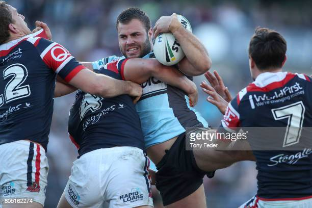 Wade Graham of the Sharks is tackled during the round 17 NRL match between the Sydney Roosters and the Cronulla Sharks at Central Coast Stadium on...