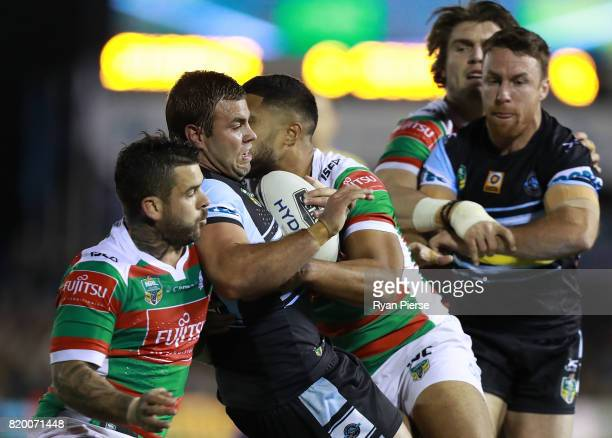 Wade Graham of the Sharks is tackled during the round 20 NRL match between the Cronulla Sharks and the South Sydney Rabbitohs at Southern Cross Group...