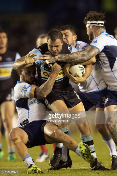 Wade Graham of the Sharks is tackled during the round eight NRL match between the Cronulla Sharks and the Gold Coast Titans at Southern Cross Group...