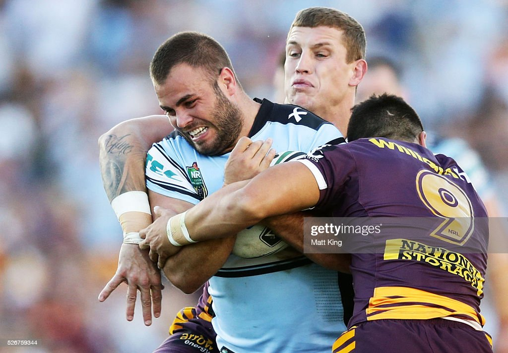 Wade Graham of the Sharks is tackled during the round nine NRL match between the Cronulla Sharks and the Brisbane Broncos at Southern Cross Group Stadium on May 1, 2016 in Sydney, Australia.