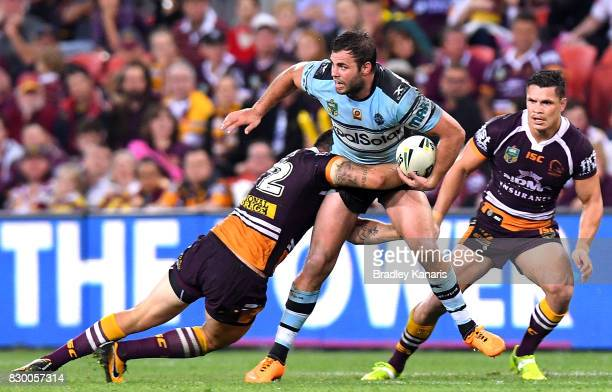 Wade Graham of the Sharks looks to pass during the round 23 NRL match between the Brisbane Broncos and the Cronulla Sharks at Suncorp Stadium on...