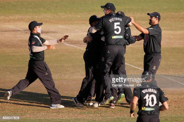 Wade King of Victoria celebrates a run out with team mates during the National Indigenous Cricket Championships Final between New South Wales and...
