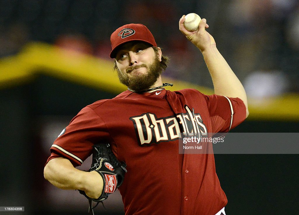 Wade Miley #36 of the Arizona Diamondbacks delivers a pitch against the San Diego Padres at Chase Field on August 28, 2013 in Phoenix, Arizona.