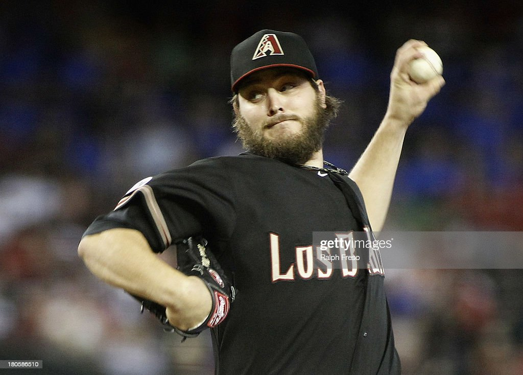 Wade Miley #36 of the Arizona Diamondbacks delivers a pitch against the Colorado Rockies during the first inning of a MLB game at Chase Field on September 14, 2013 in Phoenix, Arizona.