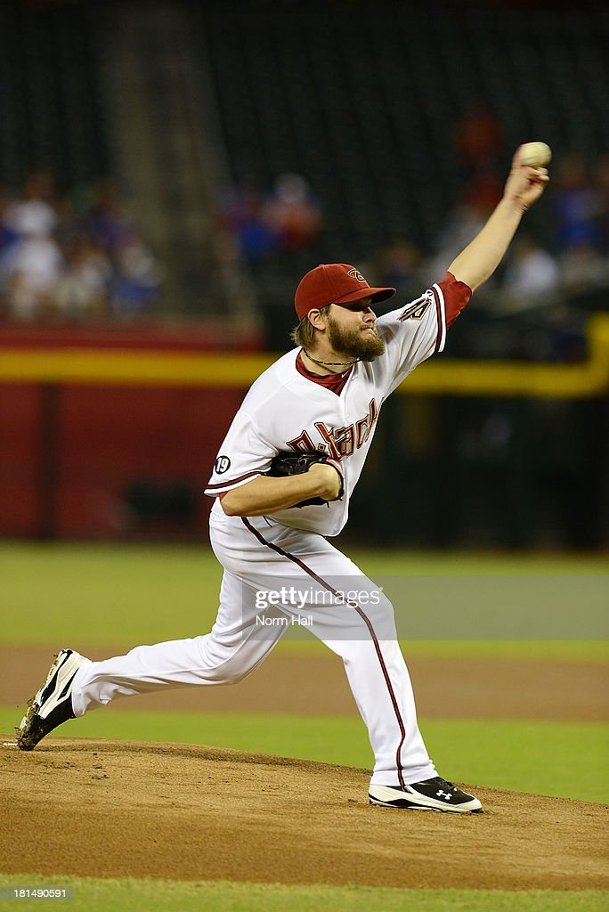 Wade Miley #36 of the Arizona Diamondbacks delivers a pitch against the Los Angeles Dodgers at Chase Field on September 19, 2013 in Phoenix, Arizona.