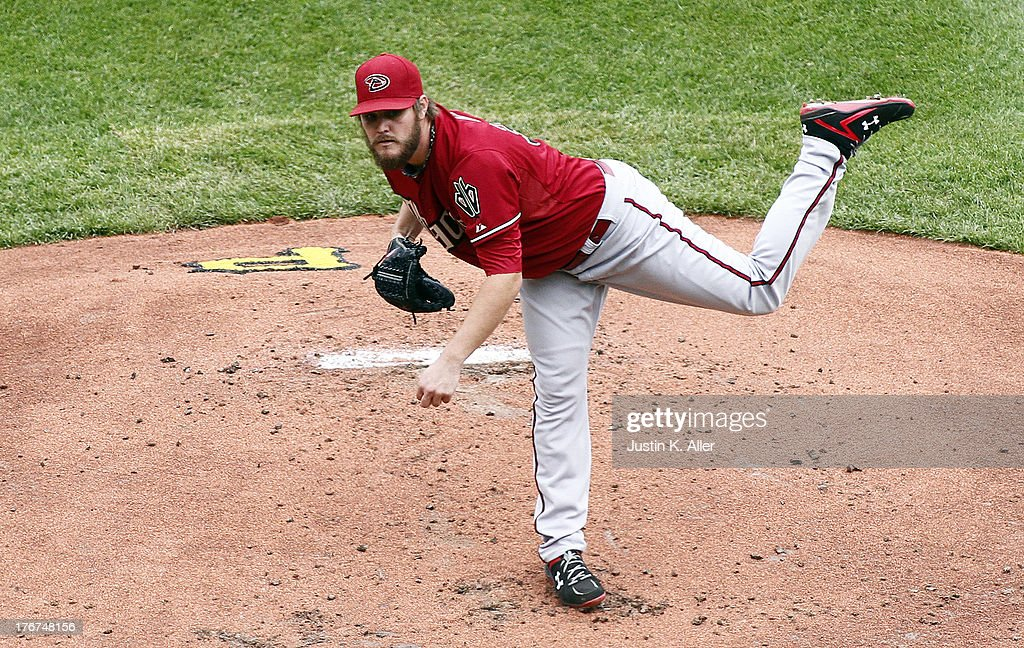 <a gi-track='captionPersonalityLinkClicked' href=/galleries/search?phrase=Wade+Miley&family=editorial&specificpeople=7511054 ng-click='$event.stopPropagation()'>Wade Miley</a> #36 of the Arizona Diamondbacks pitches in the first inning against the Pittsburgh Pirates during the game on August 18, 2013 at PNC Park in Pittsburgh, Pennsylvania.