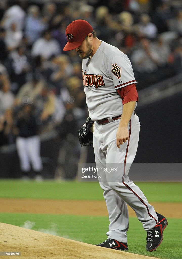 Wade Miley #36 of the Arizona Diamondbacks reacts after giving up a three-run homer during the fourth inning of a baseball game against the San Diego Padres at Petco Park on June 15, 2013 in San Diego, California.