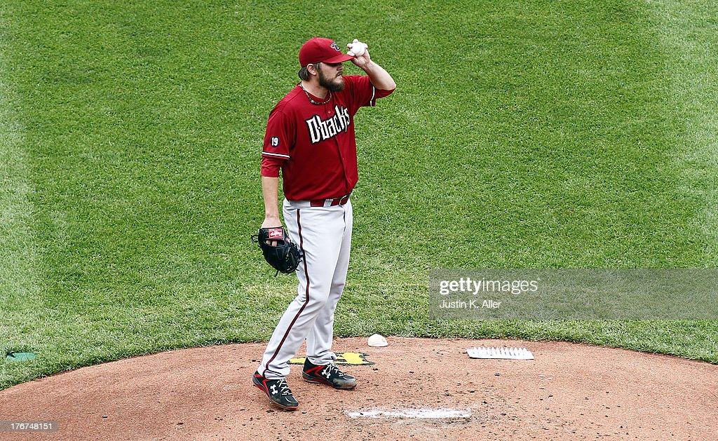 Wade Miley #36 of the Arizona Diamondbacks reacts after giving up a RBI double in the first inning against the Pittsburgh Pirates during the game on August 18, 2013 at PNC Park in Pittsburgh, Pennsylvania.