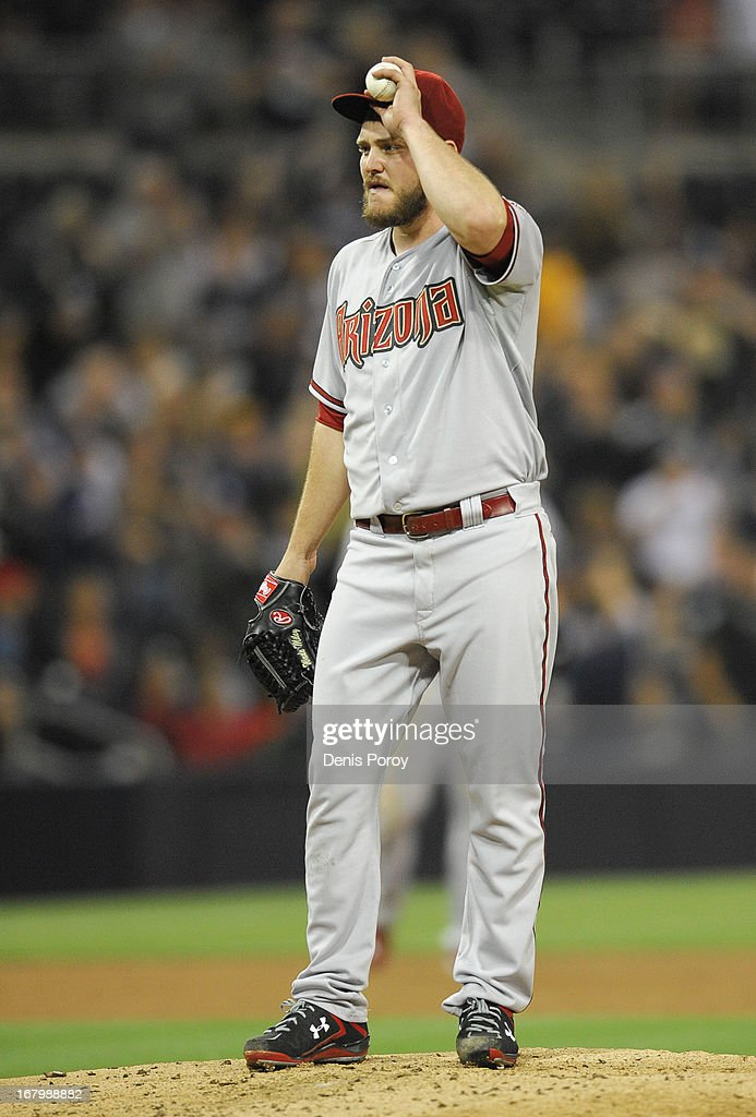 <a gi-track='captionPersonalityLinkClicked' href=/galleries/search?phrase=Wade+Miley&family=editorial&specificpeople=7511054 ng-click='$event.stopPropagation()'>Wade Miley</a> #36 of the Arizona Diamondbacks stands on the mound after giving up a two-run home run to Yonder Alonso (not pictured) of the San Diego Padres during the fifth inning of a baseball game at Petco Park on May 3, 2013 in San Diego, California.