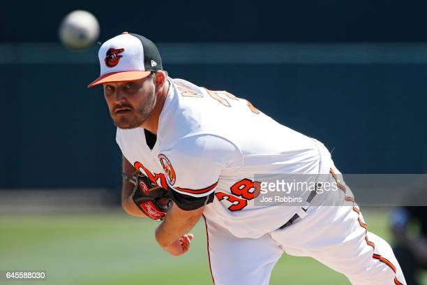 Wade Miley of the Baltimore Orioles warms up before the first inning of a spring training game against the Pittsburgh Pirates at Ed Smith Stadium on...