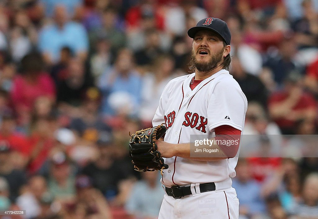 Wade Miley of the Boston Red Sox reacts after allowing two runs against the Atlanta Braves in the fourth inning at Fenway Park on June 16 2015 in...