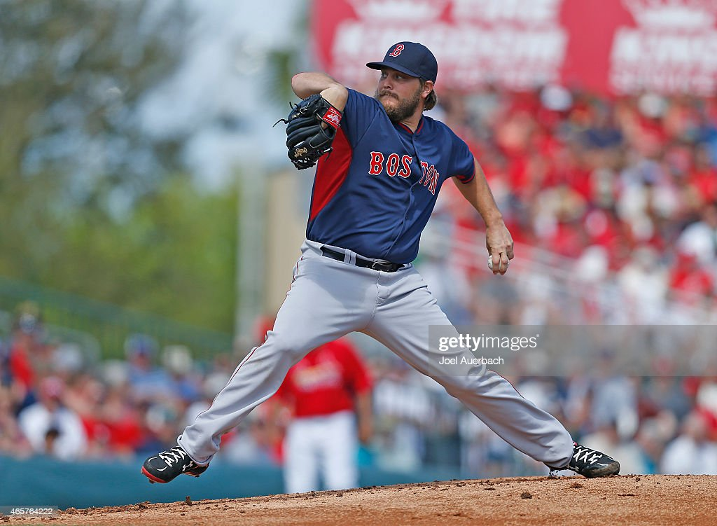 Wade Miley of the Boston Red Sox throws the ball against the St Louis Cardinals during a spring training game at Roger Dean Stadium on March 9 2015...