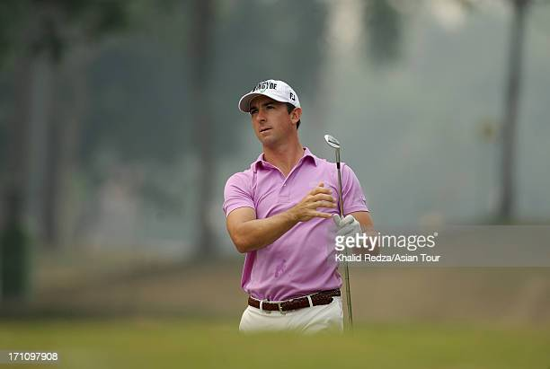Wade Ormsby of Australia plays a shot during round three of the 2013 Selangor Masters at Seri Selangor Golf Club on June 22 2013 in Petaling Jaya...