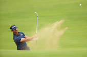 Wade Ormsby of Australia plays from a bunker on the 17th hole during the final round of the Trophee Hassan II at Golf du Palais Royal on March 29...
