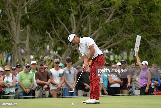 Wade Ormsby of Australia putts on the 16th hole during day three of the 2014 Australian PGA Championship at Royal Pines Resort on December 13 2014 in...