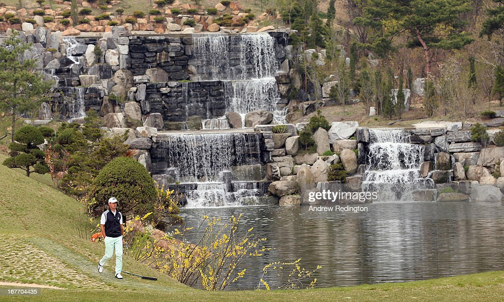 Wade Ormsby of Australia walks past the waterfall on the fourth hole during the final round of the Ballantine's Championship at Blackstone Golf Club on April 28, 2013 in Icheon, South Korea.