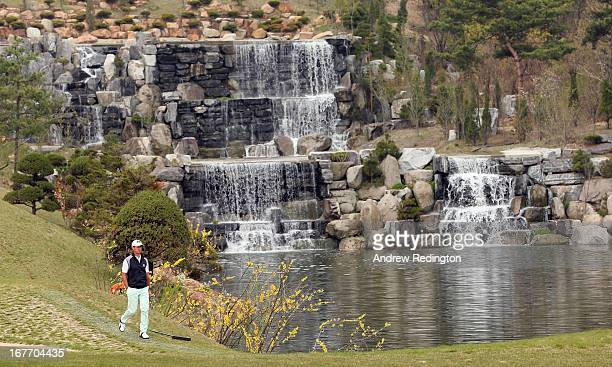Wade Ormsby of Australia walks past the waterfall on the fourth hole during the final round of the Ballantine's Championship at Blackstone Golf Club...