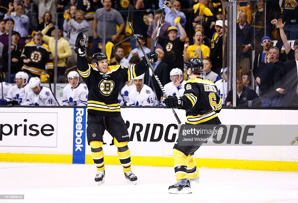 Wade Redden #6 of the Boston Bruins is congratulated by teammate Shawn Thornton #22 of the Boston Bruins after scoring a goal in the first period against the Toronto Maple Leafs in Game One of the Eastern Conference Quarterfinals during the 2013 NHL Stanley Cup Playoffs on May 1, 2013 at TD Garden in Boston, Massachusetts.