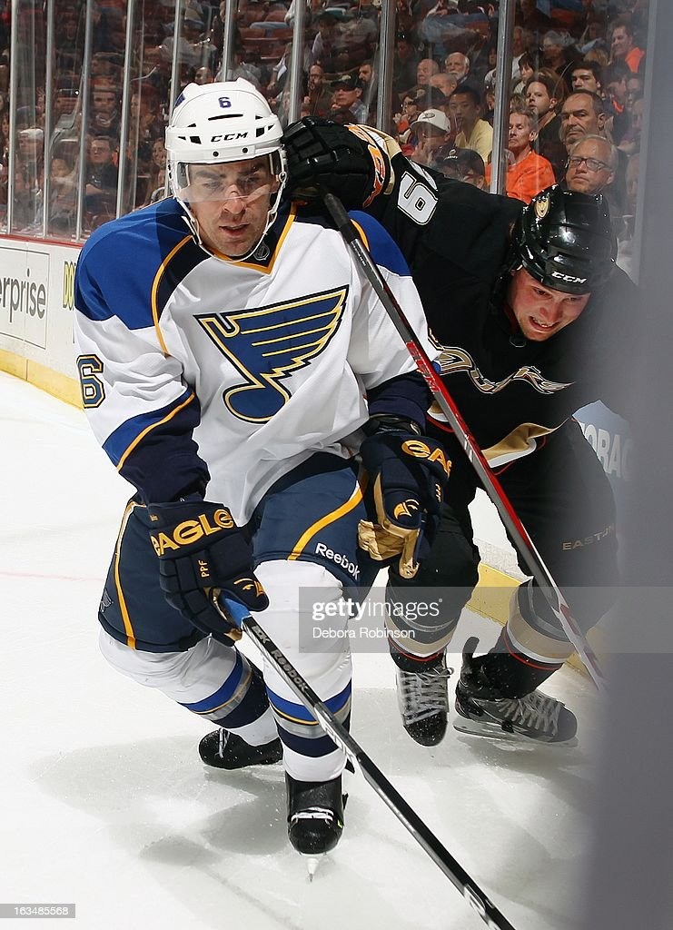 Wade Redden #6 of the St. Louis Blues lunges for the puck against Matt Beleskey #39 of the Anaheim Ducks on March 10, 2013 at Honda Center in Anaheim, California.