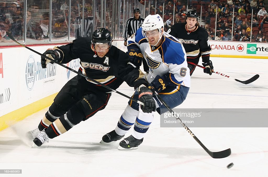 Wade Redden #6 of the St. Louis Blues tries to block Teemu Selanne #8 of the Anaheim Ducks from controlling the puck on March 10, 2013 at Honda Center in Anaheim, California.