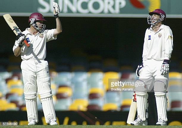 Wade Seccombe and James Hopes have a laugh during the Pura Cup match between the Queensland Bulls and Western Australia at Brisbane Cricket Ground on...