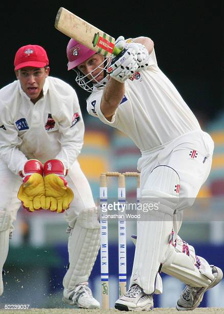 Wade Seccombe of the Bulls hits out during day 2 of the Pura Cup match between the Queensland Bulls and South Australia Redbacks at the Gabba...