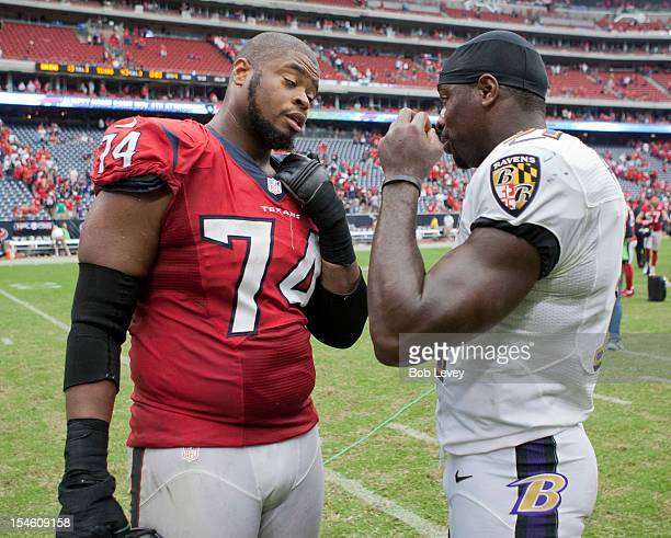 Wade Smith of the Houston Texans and Bernard Pollard of the Baltimore Ravens talk after the game at Reliant Stadium on October 21 2012 in Houston...