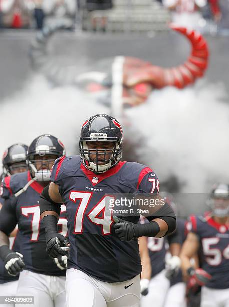 Wade Smith of the Houston Texans runs out on the field before the Houston Texans played against the New England Patriots on December 1 2013 at...