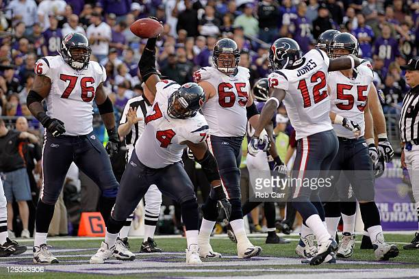 Wade Smith of the Houston Texans spikes the ball after recovering a fumble in the endzone for a touchdown against the Baltimore Ravens during the...
