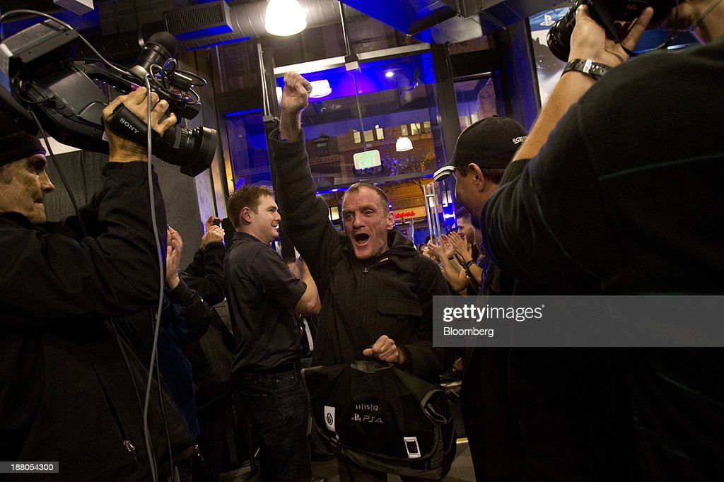 Wade Smith pumps his fist after purchasing the first Sony PlayStation 4 console of the night during its midnight launch event in San Francisco, California, U.S., on Thursday, Nov. 14, 2013. Sony Corp., poised to release the PlayStation 4 game console this week, is confident it can meet analysts' sales estimates of 3 million units by year-end, exploiting an early advantage over Microsoft Corp.'s Xbox One. Photographer: Erin Lubin/Bloomberg via Getty Images