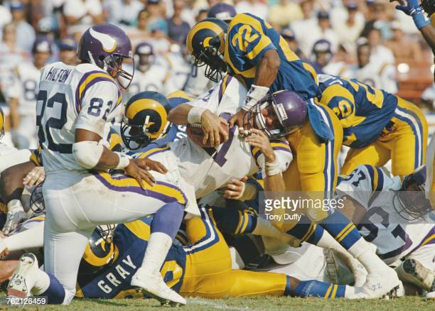 Wade Wilson Quarterback for the Minnesota Vikings is tackled and sacked by Vince Newsome and the Los Angeles Rams defence during their National...